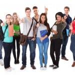 Confident University Students Walking Over White Background — Stock Photo #44591893