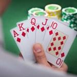 Man Playing Winning Hand Of Poker — Stock Photo