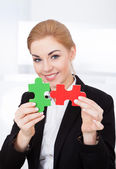 Businesswoman Holding Jigsaw Puzzle — Stock Photo