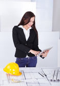 Architect With Digital Tablet Standing At Desk — Stock Photo