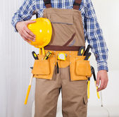 Repairman Holding Drill Machine In Living Room — Stock Photo