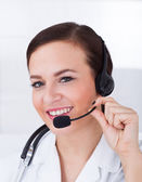 Confident Female Doctor Wearing Headset — ストック写真