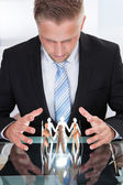 Businessman Taking Care Of Paper People — Stock Photo