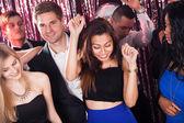 Cheerful Friends Dancing In Nightclub — Stock Photo