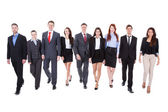 Large group of business people walking — Stock Photo