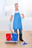 Janitor cleaning wooden floors — Foto Stock
