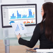 Businesswoman Analyzing Charts — Stock Photo #45259971