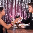 Couple Toasting Wineglasses At Restaurant Table — Stock Photo