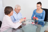 Caretaker Playing Cards With Senior Couple — Stock Photo