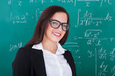 Happy Teacher Against Chalkboard — Stok fotoğraf