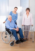Disabled Senior Couple With Caregiver — Stock Photo