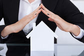 Businesswoman Covering House Model — Stock Photo
