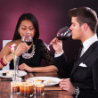 Couple Toasting Wineglasses At Restaurant Table — Stock Photo #45260829