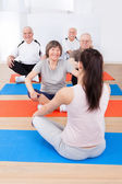 Trainer Training Customers In Yoga Class — Foto de Stock
