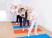 Trainer And Customers Doing Stretching Exercise — Stock Photo