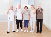 Confident People Showing Thumbs Up At Healthclub — Stock Photo