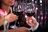 Couple Toasting Wineglasses In Restaurant — Stock Photo