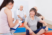 Trainer Taking Notes From Senior Customers — Foto Stock