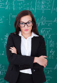Confident Teacher Standing Arms Crossed — Foto Stock