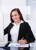 Businesswoman Using Computer In Office — Stock Photo