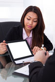 Businesswoman Showing Digital Tablet To Colleague — Stock Photo