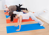 Trainer And Customers Doing Exercises — Stock Photo