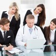 Doctor And Businesspeople Using Laptop — Stock Photo #46204253