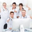 Confident Doctors Gesturing Thumbs Up — Stock Photo #46204573