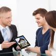 Businessman Showing House Picture To Couple On Tablet — Stock Photo #46205457