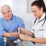 Doctor Using Lancelet On Senior Man — Stock Photo #46205503