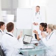Doctors Clapping For Colleague After Presentation — Stock Photo #46205509