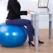 Businesswoman Working While Sitting On Pilates Ball — Stock Photo #46205995