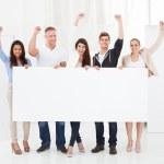 Confident Businesspeople Holding Blank Billboard — Stock Photo