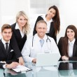 Doctor And Businesspeople Using Laptop — Stock Photo #46206393