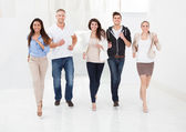 Confident Businesspeople Running Together — Stock Photo