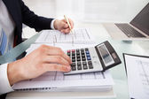Businessman Holding Calculating Expense In Office — Stock Photo