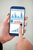Businesswoman's Analyzing Charts On Smartphone — Stock Photo