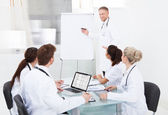 Doctor Giving Presentation To Colleagues — Stock Photo