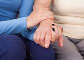 Female Caregiver Consoling Senior Woman — Stock Photo