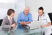 Senior Couple Consulting Doctor — Stock Photo