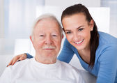 Caretaker With Senior Man At Nursing Home — Stock Photo