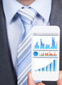 Businessman Showing Graphs On Smartphone — Стоковое фото