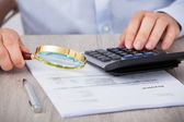 Male Auditor Scrutinizing Financial Documents — Stock Photo