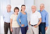 Confident Caregiver With Senior People — Stock Photo