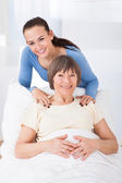 Portrait Of Happy Caregiver With Senior Woman — Stock Photo
