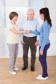 Caregiver Shaking Hands With Senior Couple — Stock Photo