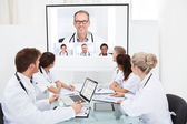 Team Of Doctors Looking At Projector Screen — Stock Photo