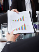 Businesswoman Giving Progress Chart To Colleague — Stock Photo