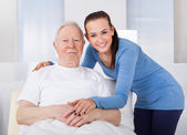 Caregiver Consoling Senior Man — Stock Photo