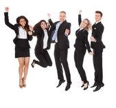 腕を上げると、成功したここビジネスマン — ストック写真